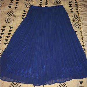 Pleated swing skirt.